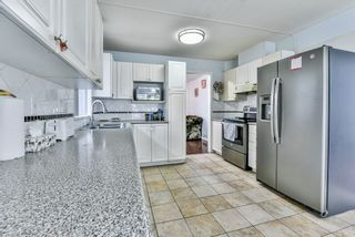 """Photo 13: 31 7330 122 Street in Surrey: West Newton Townhouse for sale in """"STRAWBERRY HILL ESTATES"""" : MLS®# R2267551"""