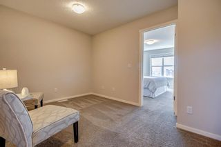 Photo 20: 100 Legacy Main Street SE in Calgary: Legacy Row/Townhouse for sale : MLS®# A1095155