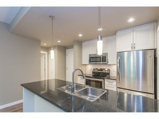 """Photo 7: 104 2238 WHATCOM Road in Abbotsford: Abbotsford East Condo for sale in """"Waterleaf"""" : MLS®# R2260128"""