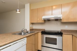 """Photo 4: 211 3278 HEATHER Street in Vancouver: Cambie Condo for sale in """"HEATHERSTONE"""" (Vancouver West)  : MLS®# R2030479"""