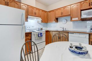Photo 10: 111 72 Quigley Drive: Cochrane Apartment for sale : MLS®# A1137797