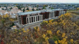 Photo 4: 214 15 Cougar Ridge Landing SW in Calgary: Patterson Apartment for sale : MLS®# A1095933