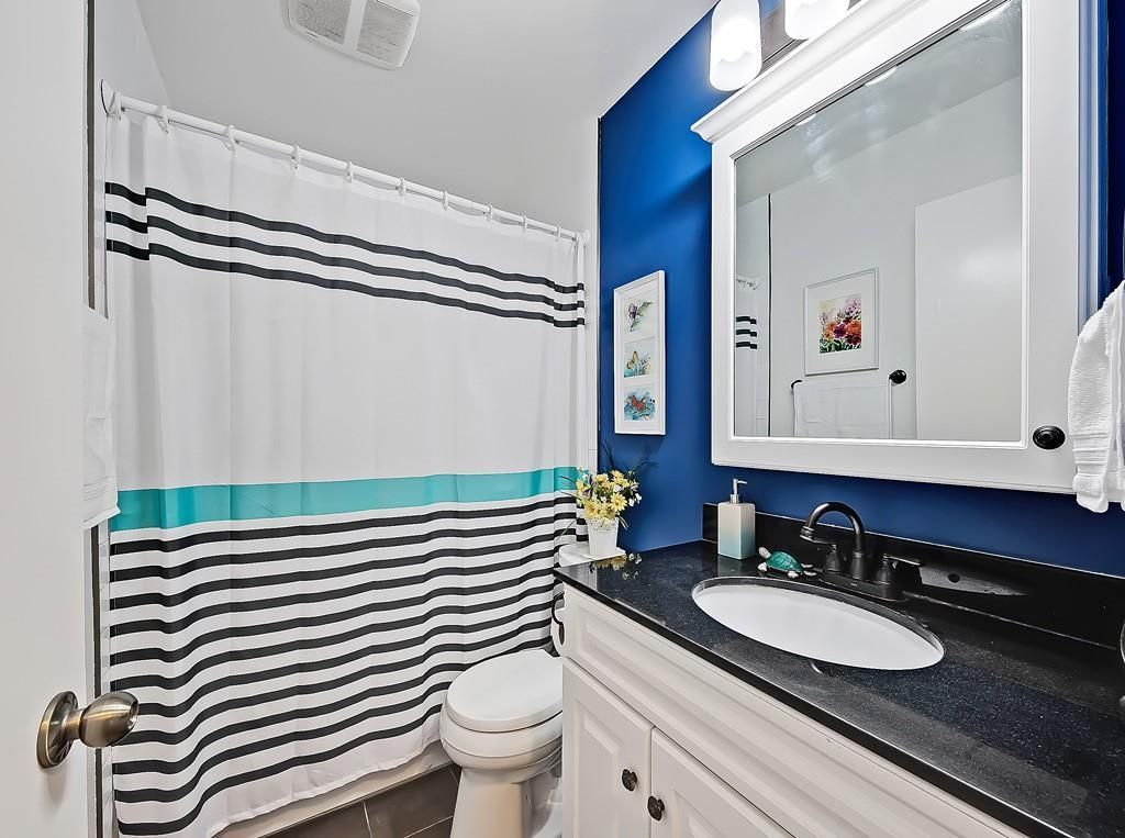 Photo 17: Photos: 7607 68 Avenue NW in Calgary: Silver Springs Detached for sale : MLS®# A1024824