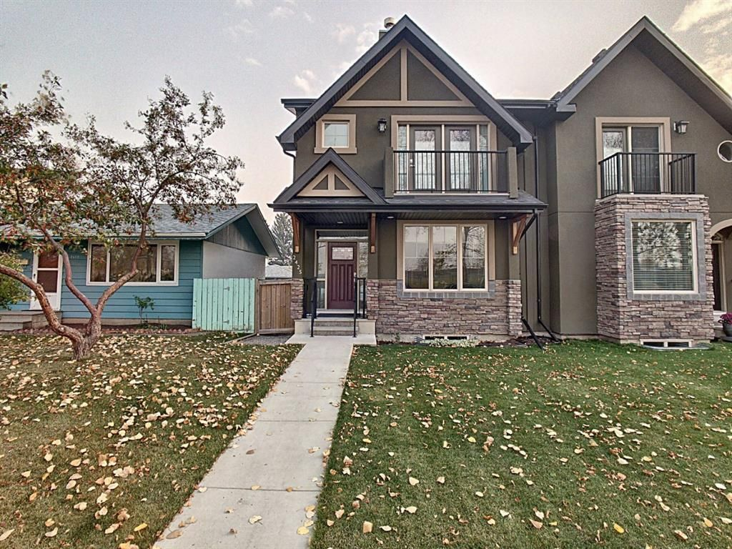 Main Photo: 2425 52 Avenue SW in Calgary: North Glenmore Park Semi Detached for sale : MLS®# A1153044