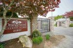 """Main Photo: 403 21937 48 Avenue in Langley: Murrayville Townhouse for sale in """"ORANGEWOOD"""" : MLS®# R2577269"""