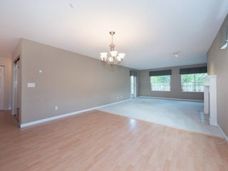 "Photo 3: 220 13880 70 Avenue in Surrey: East Newton Condo for sale in ""Chelsea Gardens"" : MLS®# R2288215"