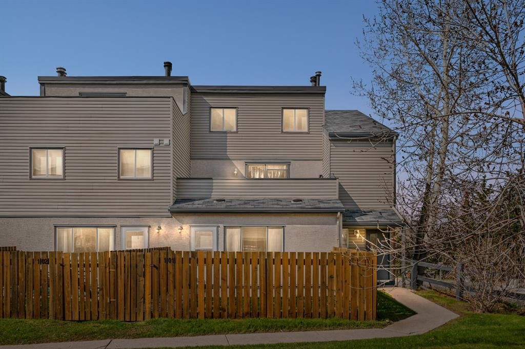 Fenced main floor unit.  Across the street from Foothills & new cancer centre.