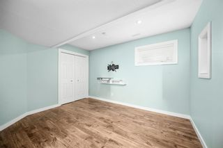 Photo 24: 5 Cougar Ridge Mews SW in Calgary: Cougar Ridge Row/Townhouse for sale : MLS®# A1105171