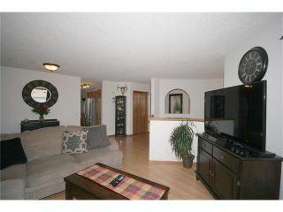 Photo 10: 35 WEST MCDOUGAL Road: Cochrane House for sale : MLS®# C4053037