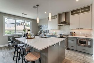 Photo 9: 1587 38 Avenue SW in Calgary: Altadore Row/Townhouse for sale : MLS®# A1020976