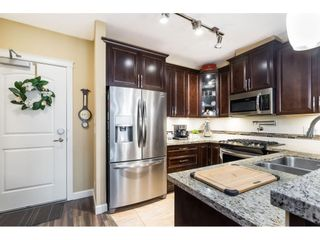 """Photo 3: A409 8218 207A Street in Langley: Willoughby Heights Condo for sale in """"Yorkson Creek (Final Phase) Walnut Ridge"""" : MLS®# R2597596"""