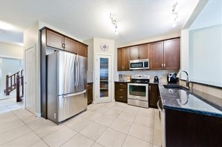 Photo 8: 58 EVERHOLLOW MR SW in Calgary: Evergreen House for sale : MLS®# C4255811