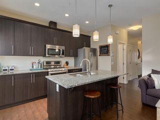 Photo 8: 438 Quarry Villas SE in Calgary: Douglasdale/Glen Row/Townhouse for sale : MLS®# A1057271