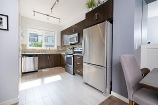 Photo 3: 393 WALDEN Drive SE in Calgary: Walden Row/Townhouse for sale : MLS®# A1126441