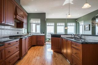 Photo 17: 40 Slopes Grove SW in Calgary: Springbank Hill Detached for sale : MLS®# A1069475