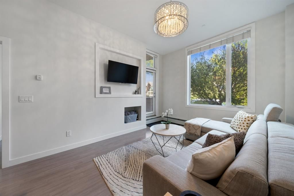 Main Photo: 103 119 19 Street NW in Calgary: West Hillhurst Apartment for sale : MLS®# A1116519