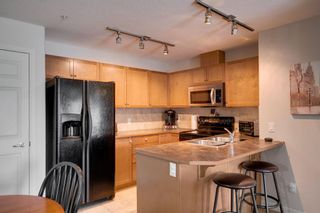 Photo 7: 1302 92 Crystal Shores Road: Okotoks Apartment for sale : MLS®# A1132113