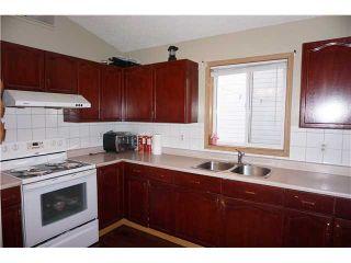 Photo 6: 7167 LAGUNA Way NE in Calgary: Monterey Park Residential Detached Single Family for sale : MLS®# C3652715