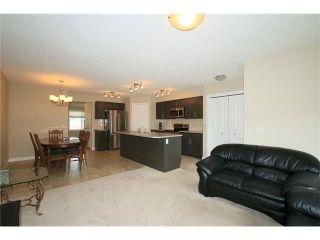 Photo 8: 7 FIRESIDE Parkway: Cochrane House for sale : MLS®# C4068645
