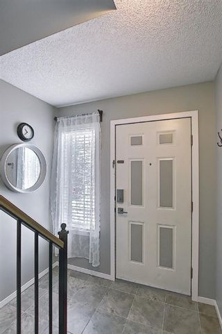 Photo 5: 101 Country Hills Villas NW in Calgary: Country Hills Row/Townhouse for sale : MLS®# A1089645