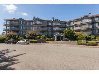 """Photo 1: 201 5375 205 Street in Langley: Langley City Condo for sale in """"Glenmont Park"""" : MLS®# R2482379"""