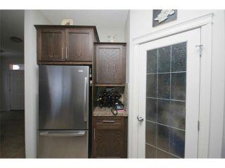 Photo 11: 38 HERITAGE Landing: Cochrane House for sale : MLS®# C4004850