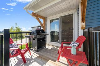 Photo 26: 1404 Jumping Pound Common: Cochrane Row/Townhouse for sale : MLS®# A1146897