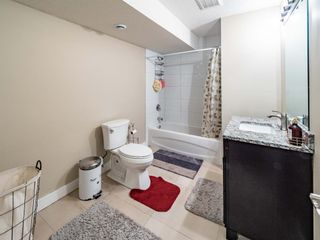 Photo 32: 159 ST MORITZ Drive SW in Calgary: Springbank Hill Detached for sale : MLS®# A1116300