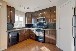 Photo 8: 106 2445 Kingsland Road SE: Airdrie Row/Townhouse for sale : MLS®# A1072510