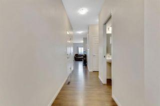 Photo 6: 333 Heartland Crescent: Cochrane Semi Detached for sale : MLS®# A1063240