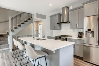 Photo 10: 1702 19 Avenue SW in Calgary: Bankview Row/Townhouse for sale : MLS®# A1078648