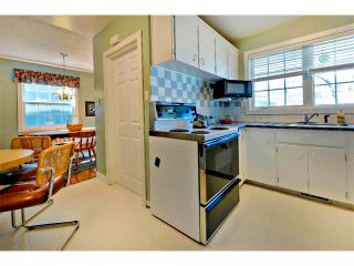 Photo 11: 2931 LATHOM Crescent SW in Calgary: Lakeview House for sale : MLS®# C4006222