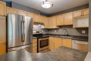 "Photo 2: 206 33478 ROBERTS Avenue in Abbotsford: Central Abbotsford Condo for sale in ""Aspen Creek"" : MLS®# R2403357"