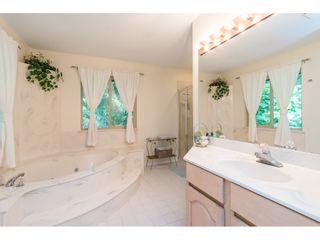 """Photo 13: 4067 199A Street in Langley: Brookswood Langley House for sale in """"BROOKSWOOD"""" : MLS®# R2461084"""