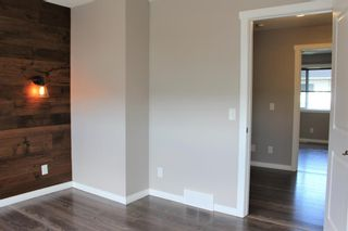 Photo 27: 1404 Clover Link: Carstairs Row/Townhouse for sale : MLS®# A1073804