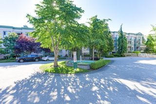 Photo 2: 310 13860 70 Avenue in Surrey: East Newton Condo for sale : MLS®# R2593741