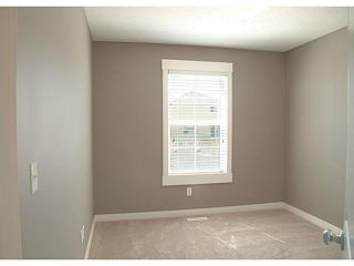 Photo 13: 452 Rainbow Falls Drive: Chestermere Townhouse for sale : MLS®# C3579282