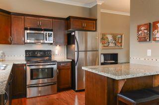 """Photo 9: 408 20286 53A Avenue in Langley: Langley City Condo for sale in """"CASA VERONA"""" : MLS®# R2177236"""