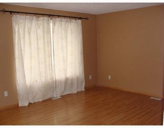Photo 2: 212 ABADAN Place NE in CALGARY: Abbeydale Residential Detached Single Family for sale (Calgary)  : MLS®# C3389732