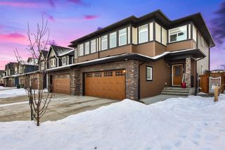 Photo 1: 207 Kinniburgh Road: Chestermere Semi Detached for sale : MLS®# A1057912