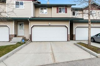 Photo 1: 111 2 Westbury Place SW in Calgary: West Springs Row/Townhouse for sale : MLS®# A1112169