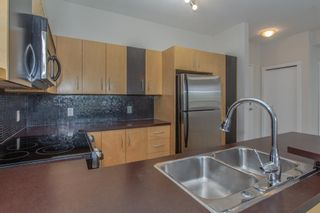Photo 3: 328 69 Springborough Court SW in Calgary: Springbank Hill Apartment for sale : MLS®# A1124627