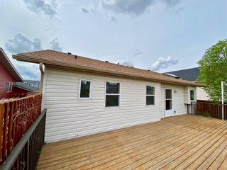 Photo 34: 309 Sunset Place: Okotoks Detached for sale : MLS®# C4300648