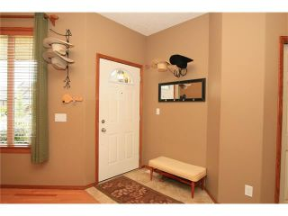 Photo 2: 18 WEST POINTE Manor: Cochrane House for sale : MLS®# C4072318