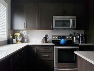 Photo 13: 179 HAWKS RIDGE Boulevard in Edmonton: Zone 59 House Half Duplex for sale : MLS®# E4261420