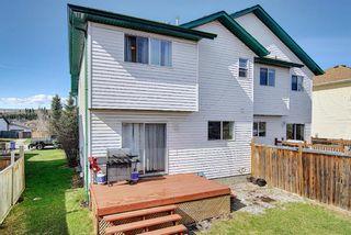 Photo 35: 226 Quigley Drive: Cochrane Semi Detached for sale : MLS®# A1107845