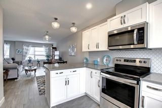 Photo 4: 1002 2461 Baysprings Link SW: Airdrie Row/Townhouse for sale : MLS®# A1151958