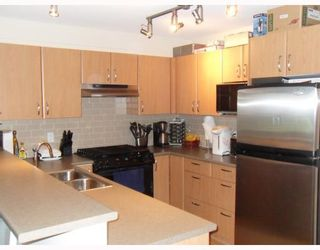 """Photo 1: 204 4783 DAWSON Street in Burnaby: Brentwood Park Condo for sale in """"COLLAGE"""" (Burnaby North)  : MLS®# V808325"""