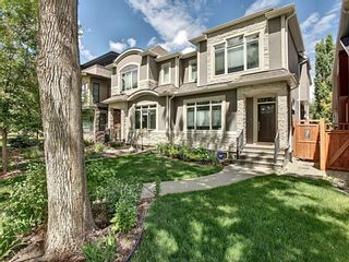 Main Photo: 2110 2 Avenue NW in Calgary: West Hillhurst Semi Detached for sale : MLS®# A1118456