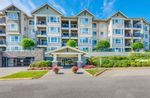 "Main Photo: 310 19677 MEADOW GARDENS Way in Pitt Meadows: North Meadows PI Condo for sale in ""The Fairways"" : MLS®# R2565149"